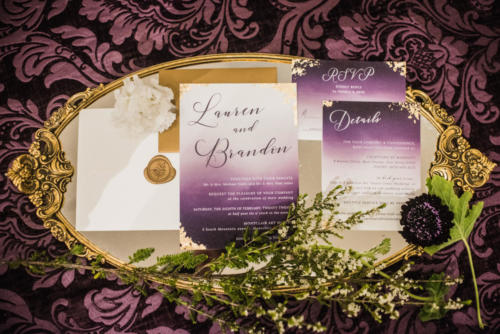 Moody watercolor wedding invitation suite with gold leaf accents