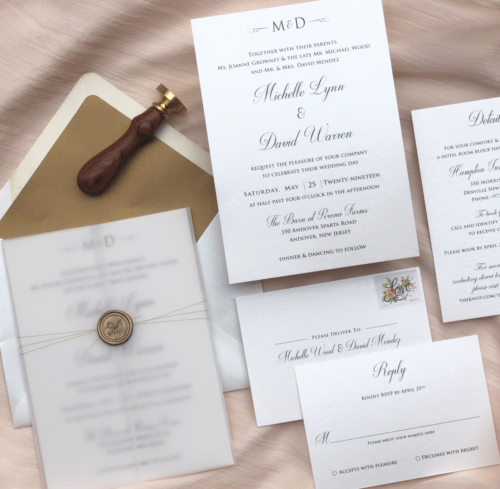 Modern, rustic wedding invitation suite with vellum sleeve and wax seal