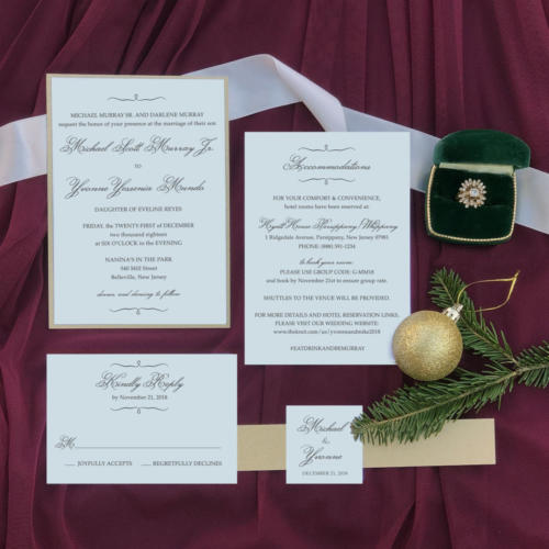 Elegant gold and ivory wedding invitation with belly band and emerald envelopes