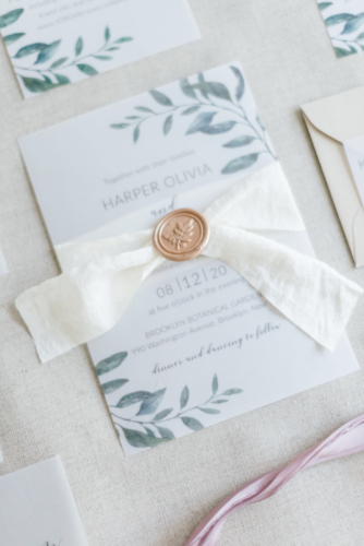 Modern vellum wedding invitation with wax seal and ribbon belly band