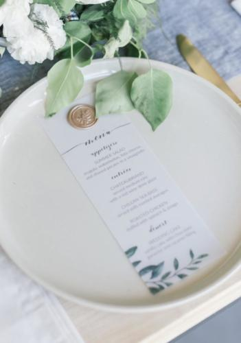 Vellum + wax seal menu card