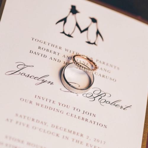 Winter wedding penguin-themed invitations
